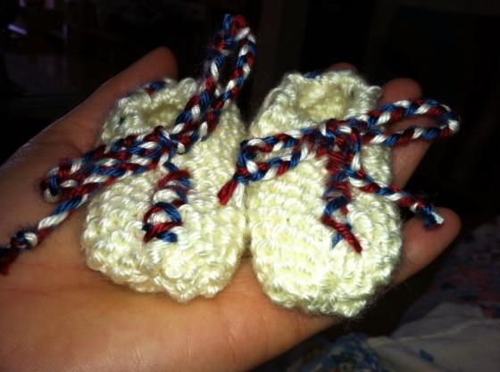 Patriotic booties, fitting for the child of a Naval Officer.
